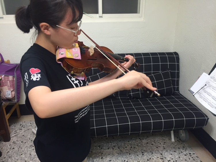 清華大學學生利用繁忙課業之餘練習,釋放壓力陶冶心靈