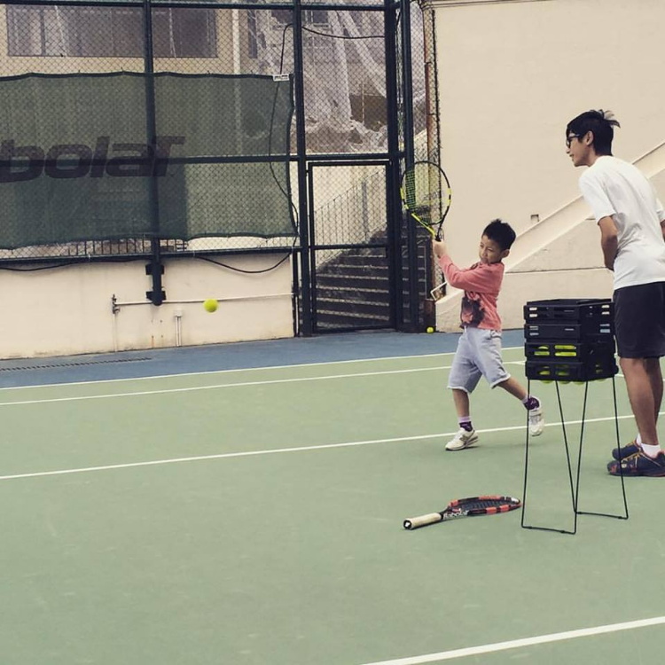 young student hitting his forehand